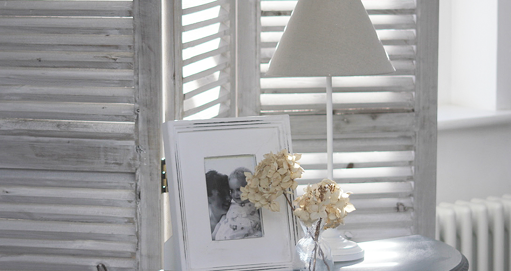 7. White table lamp and linen shade